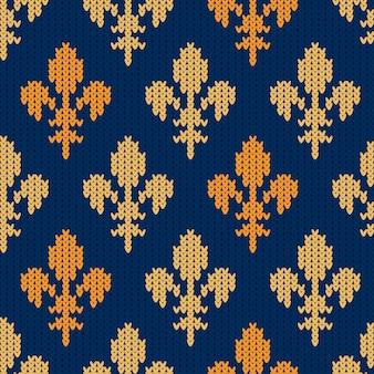 Knitted woolen pattern with heraldic golden royal lilies