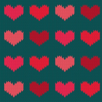 Knitted woolen seamless pattern with hearts in pink tones. valentine's day