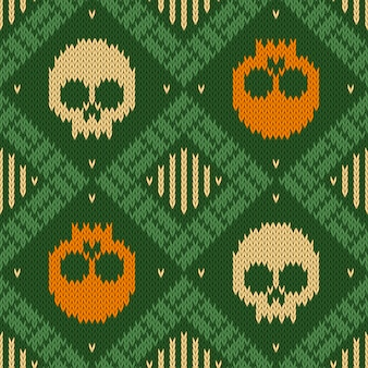 Knitted woolen seamless pattern with skulls in green shades