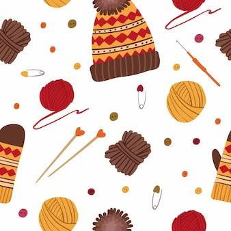 編み物の帽子と手袋のシームレスなパターン手作りのニット服手描きイラスト