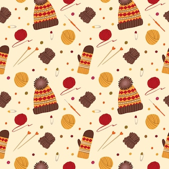 Knitting hats and gloves seamless pattern. handmade knitted clothes. yarn balls, needles, crochet, traditional autumn hobby tools, accessories.