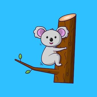 青い背景の上の木の漫画のコアラ