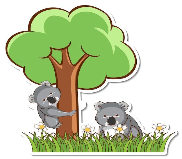 コアラのお母さんと赤ちゃんが芝生のフィールドステッカーに立っています
