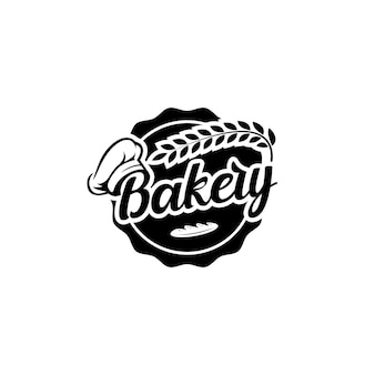シェフの帽子と小麦でエンブレムバッジベーカリーのロゴデザインにラベルを付ける