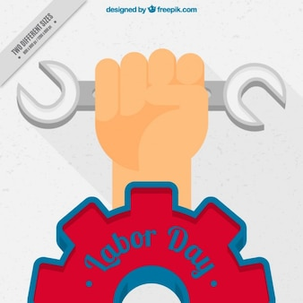 Labor day background of hand with wrench