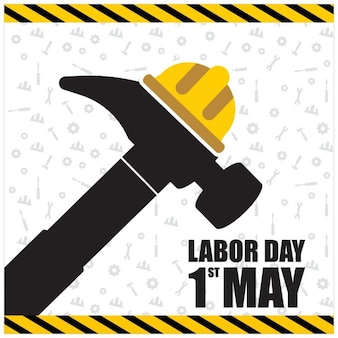 Labor day background of hammer with a helmet