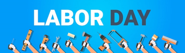 Labor day with hands holding different instruments. 1 may holiday horizontal banner