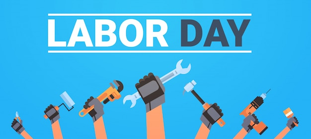 Labor day with hands holding different instruments workers holiday