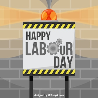 Labour day background with sign and brick wall