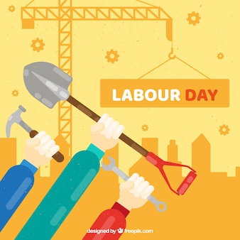 Labour day background with workers and tools