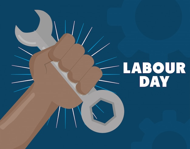 Labour day. hand with wrench key tool