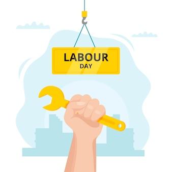 ツールを持っている手の労働者の日