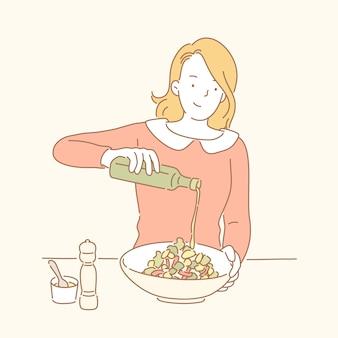 레이디가 그녀의 샐러드를 만들고 선 스타일로 올리브 오일을 추가합니다.