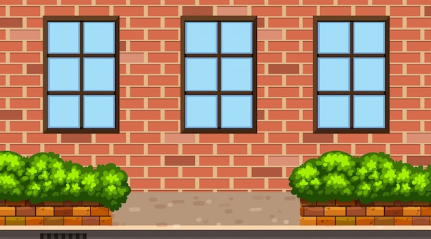 Landscape background with brick building and bush