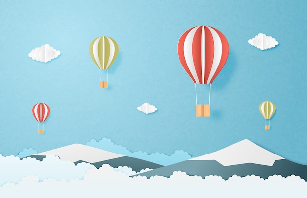 Landscape background with hot air balloon in paper cut style