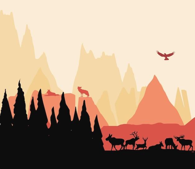 風景の森の山の動物のシルエット