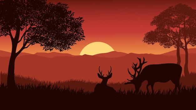Пейзаж с лесом на закате с оленями