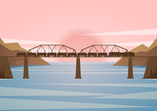夕日を背景に鉄道橋のある風景します。