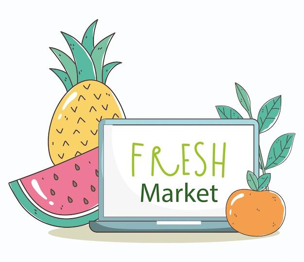 ノートパソコンと果物の新鮮な市場の有機健康食品