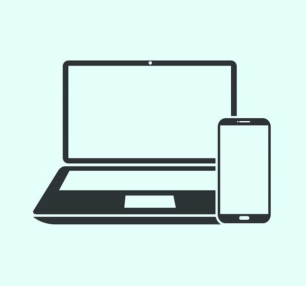 ノートパソコンと青に分離されたスマートフォン