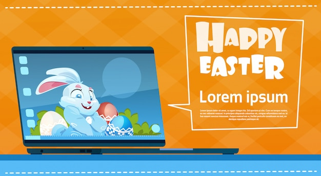 Laptop computer decorated colorful eggs rabbit easter holiday symbols greeting card
