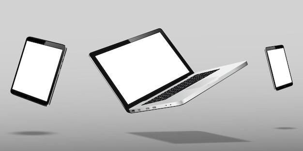 회색 배경 위에 떠있는 노트북 스마트 폰 및 태블릿