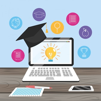 Laptop technology with smartphone and graduation cap