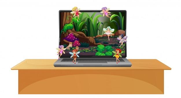 Computer portatile con scena di fiaba sullo schermo del desktop