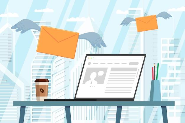 ニュースメッセージメールを受信して飛んでいる翼を持つ現代のオフィスの封筒のデスクトップ上のニュースとラップトップ