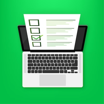 Laptop with online exam on green
