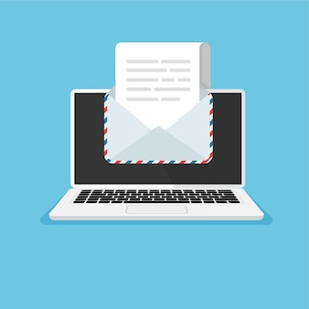 Laptop with open envelope and document on screen getting or send new letter email concept