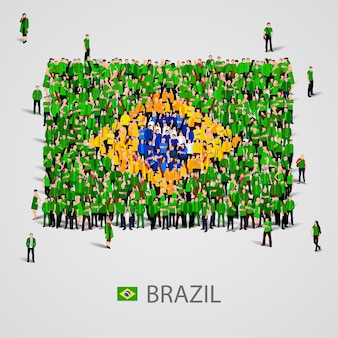 Большая группа людей в форме флага бразилии