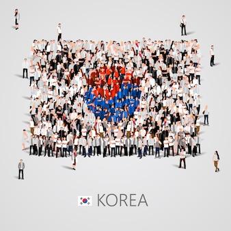 깃발 모양에있는 사람들의 큰 그룹