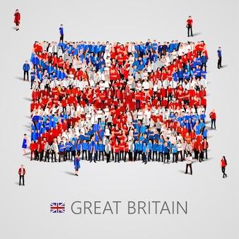 Большая группа людей в форме флага великобритании