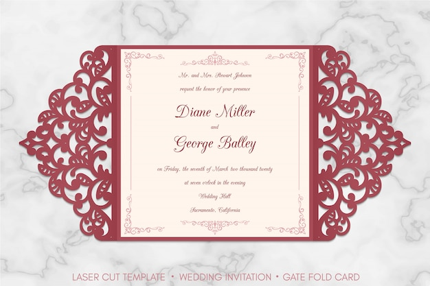 Laser cut gate fold wedding invitation card template on marble background.