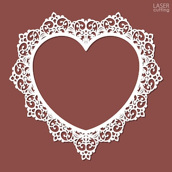 Laser cut heart-shaped frame. photo frame template with an openwork floral pattern.