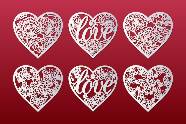 Laser cut hearts set with pattern of peonies, butterflies, flowers and word love, valentine's card design.