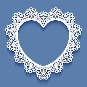 Laser cut paper lace frame in the shape of heart,  illustration. ornamental cutout photo frame