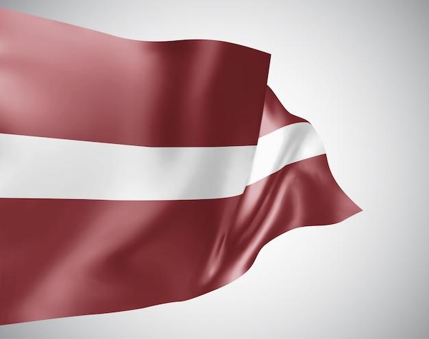 ラトビア、白い背景の上の風に手を振る波と曲がりのベクトルフラグ。