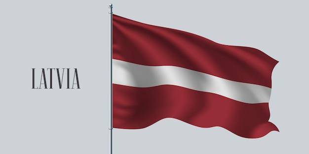 라트비아 깃대에 깃발을 흔들며