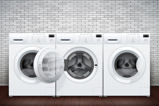 벽돌 벽에 많은 세탁기가있는 세탁실 내부