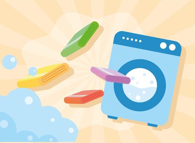 주황색 배경에 세탁용 수건과 세탁기