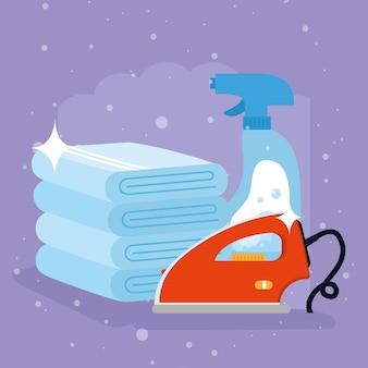 보라색 배경에 세탁용 수건 세제 스프레이와 다리미