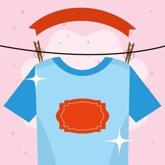 분홍색 배경에 매달려 있는 세탁용 티셔츠