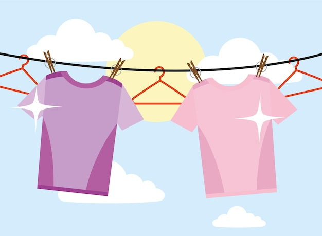 하늘 배경에 매달려 있는 세탁용 티셔츠와 옷걸이