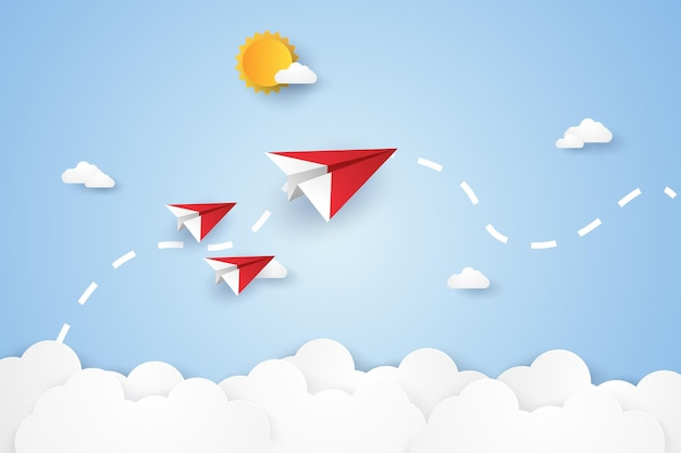 リーダーシップとチームワークの概念と紙のアートスタイルで空を飛んでいる折り紙の飛行機