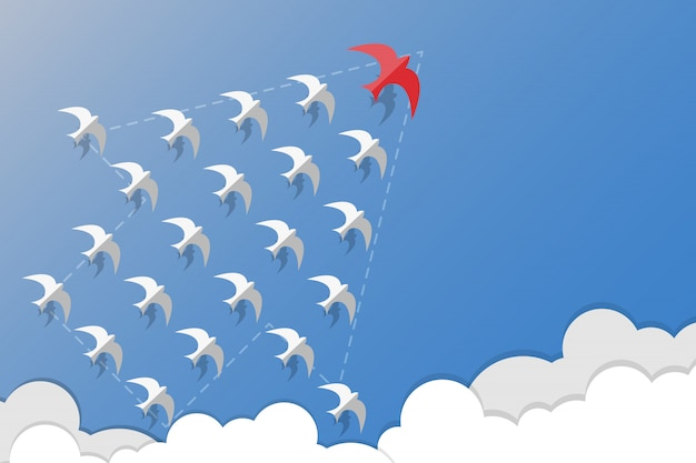 Leadership, teamwork and courage concept, red swallows leader white swallows and flying in grow arrow form on sky.