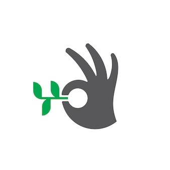 Leaf logo with hand symbol design for nature