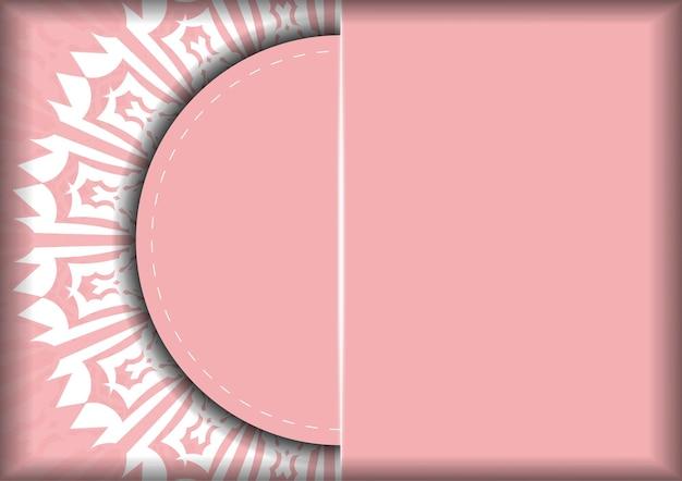 タイポグラフィ用に用意されたインドの白い装飾品が付いたピンクのリーフレット。