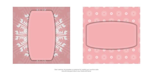 タイポグラフィ用に用意された曼荼羅の白い飾りが付いたピンクのリーフレット。